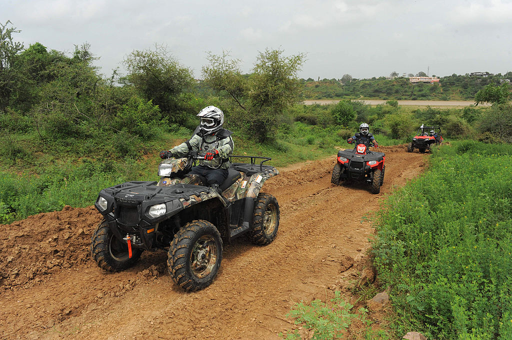 quads driving on a trail showing off their sandy ATV tires