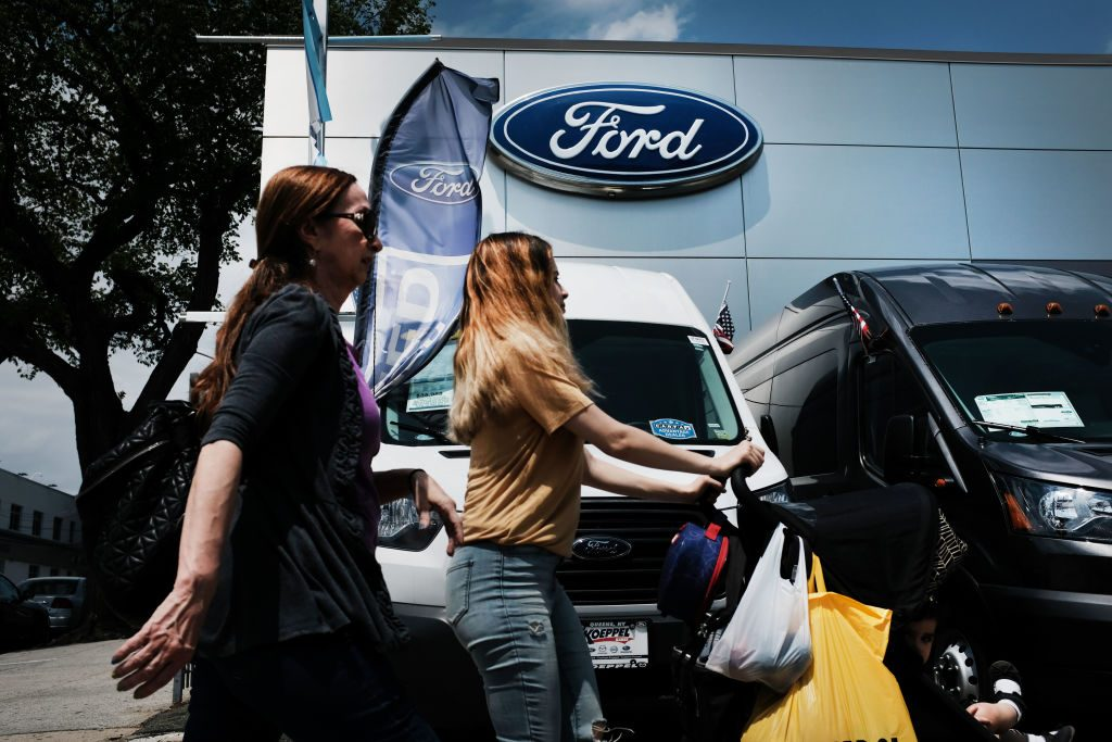 women browsing for cars at a Ford dealer