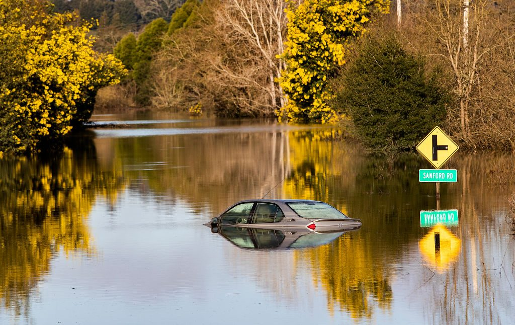 A vehicle submerged in flood waters is likely totaled