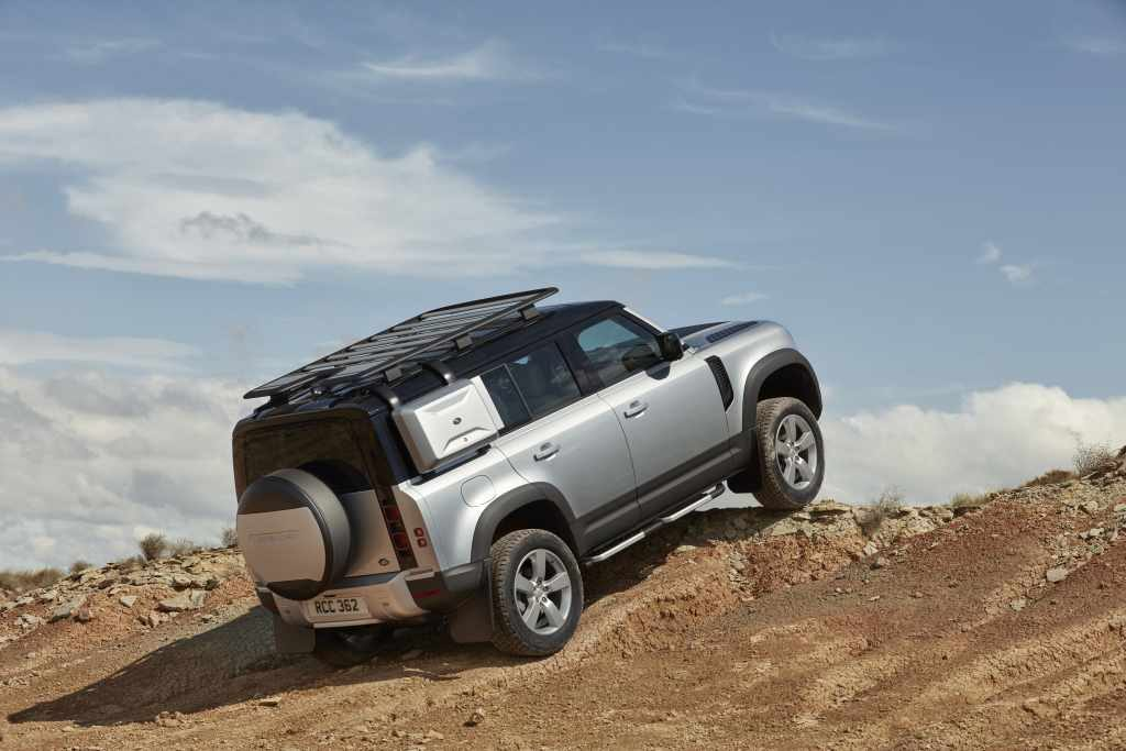 The Land Rover Defender climbing over rocks