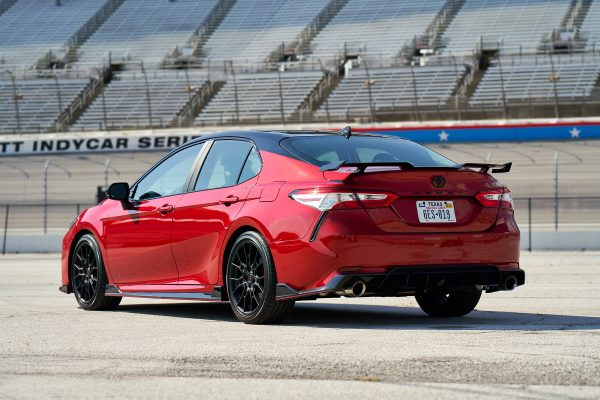 A red 2020 Toyota Camry TRD V6 parked on a race track.