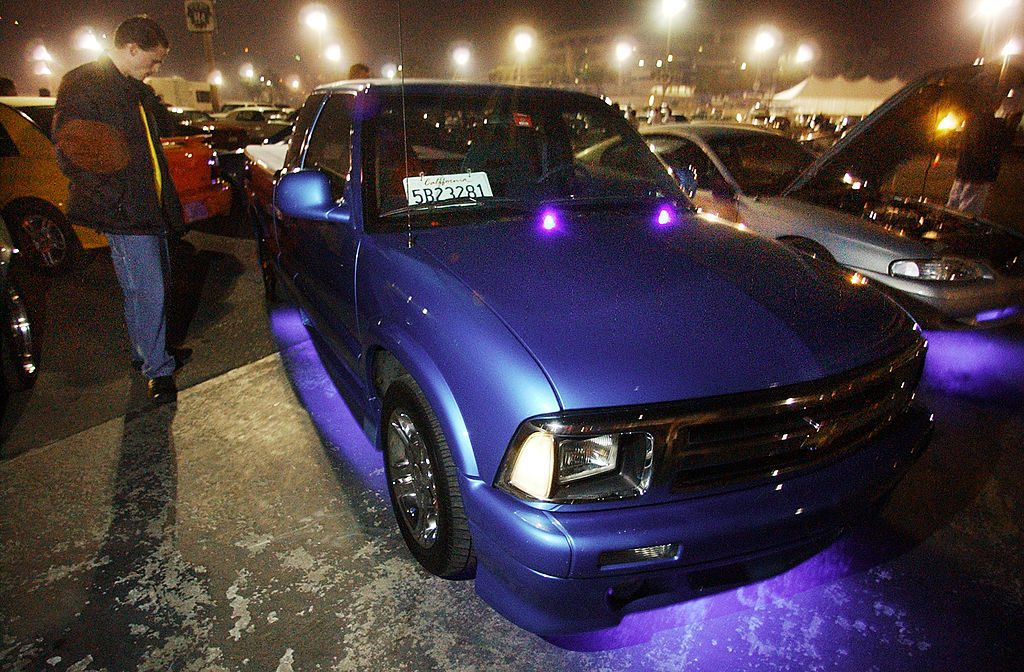 Man stands next to his modified 1995 Chevy S10