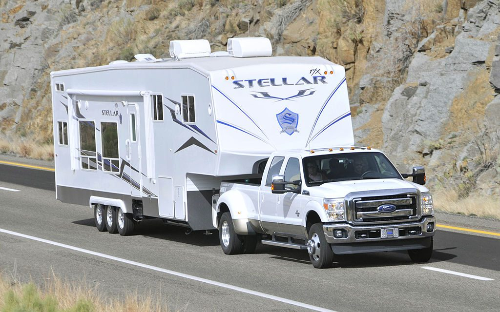 The Ford 2011 F-350 Super Duty Power Stroke diesel pickup truck pulls a 24,000-pound camping trailer