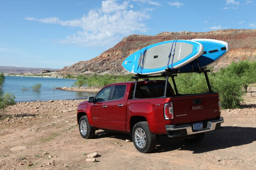 A 2019 GMC Canyon carrying standup paddleboards