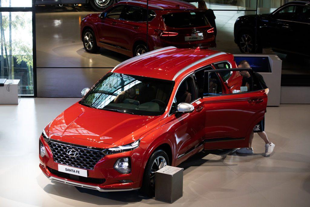 A customer looks at a Hyundai Santa Fe SUV