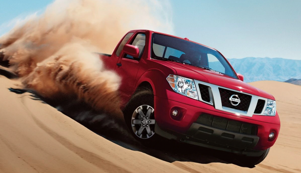 A red Nissan Frontier sanding.