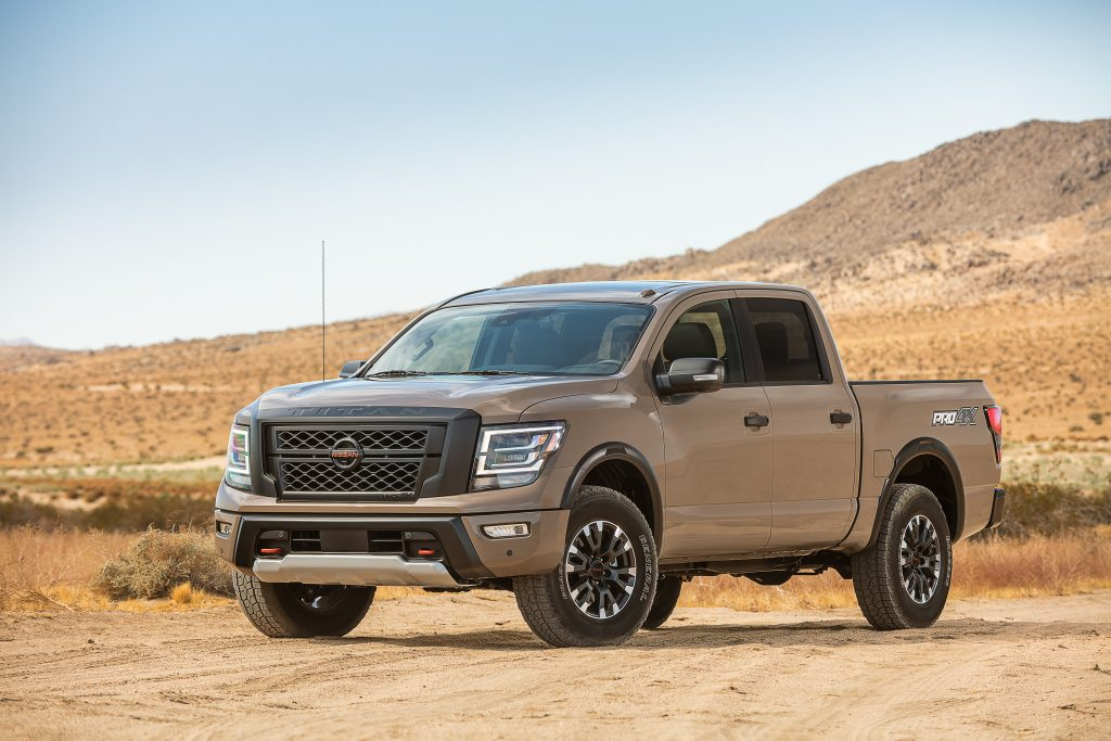 2020 Nissan TITAN PRO-4X pickup truck parked on sandy road