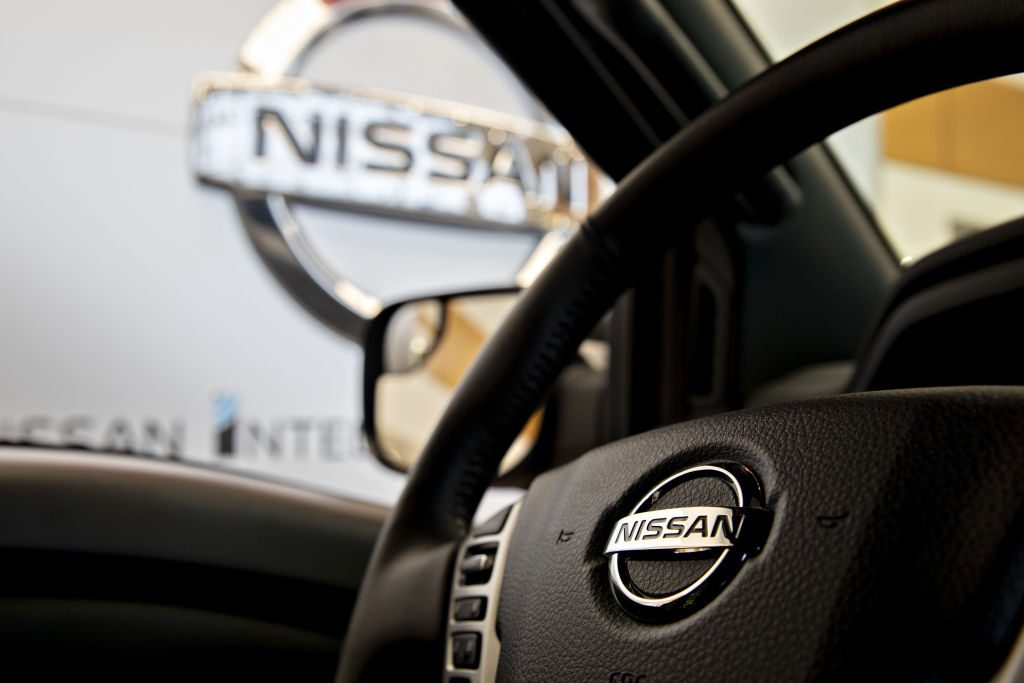 A picture from the inside of a Nissan Titan showing the steering wheel.