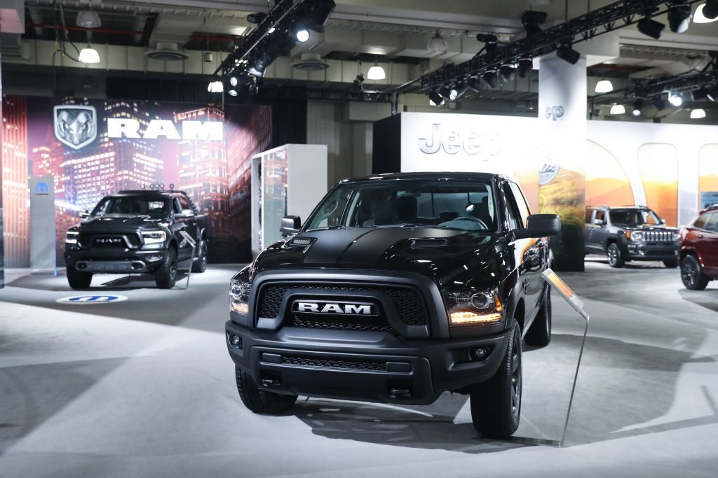 A 2020 Ram 1500 truck on display at an auto show.