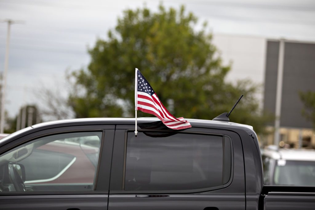 An American flag flies from the window of a 2019 Ford Ranger pickup truck