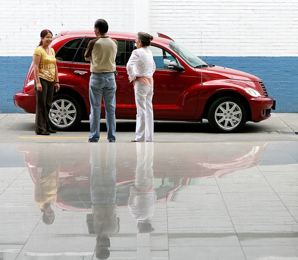 Customers look over a Chrysler PT Cruiser