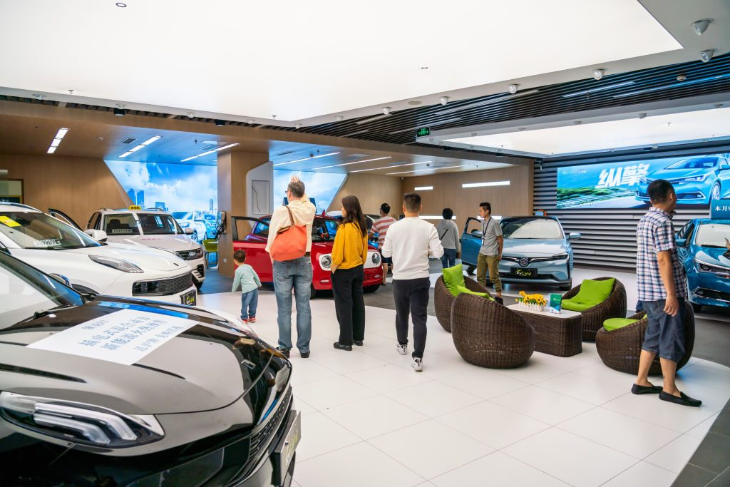 Customers visits an electric and hybrid vehicles store in Shanghai