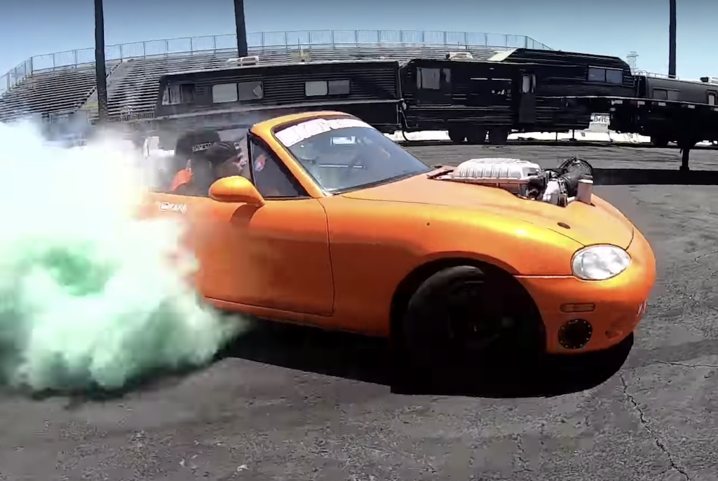 A Hellcat/Mazda Miata mashup car races away