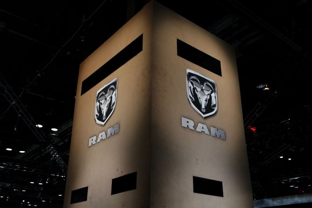 Two Dodge Ram banners hung up at an auto show.