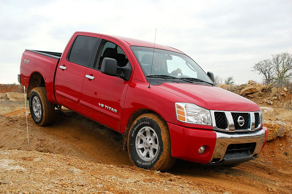 A 2006 Nissan Titan driving off-road.