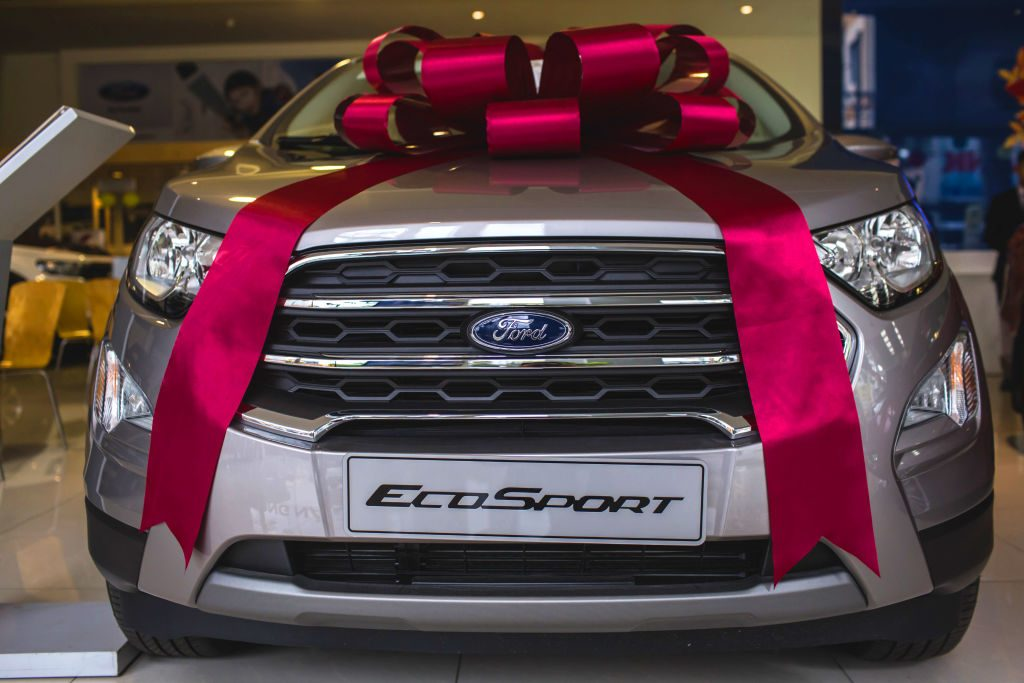 A ribbon sits on the hood of a Ford EcoSport SUV