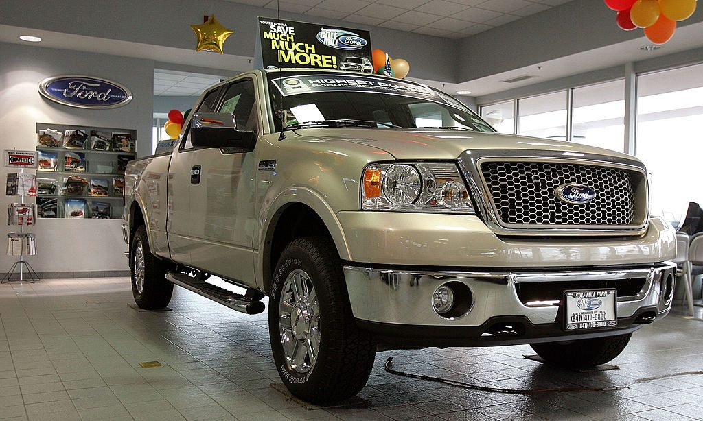 A Ford F-150 truck in the showroom of a car dealer.
