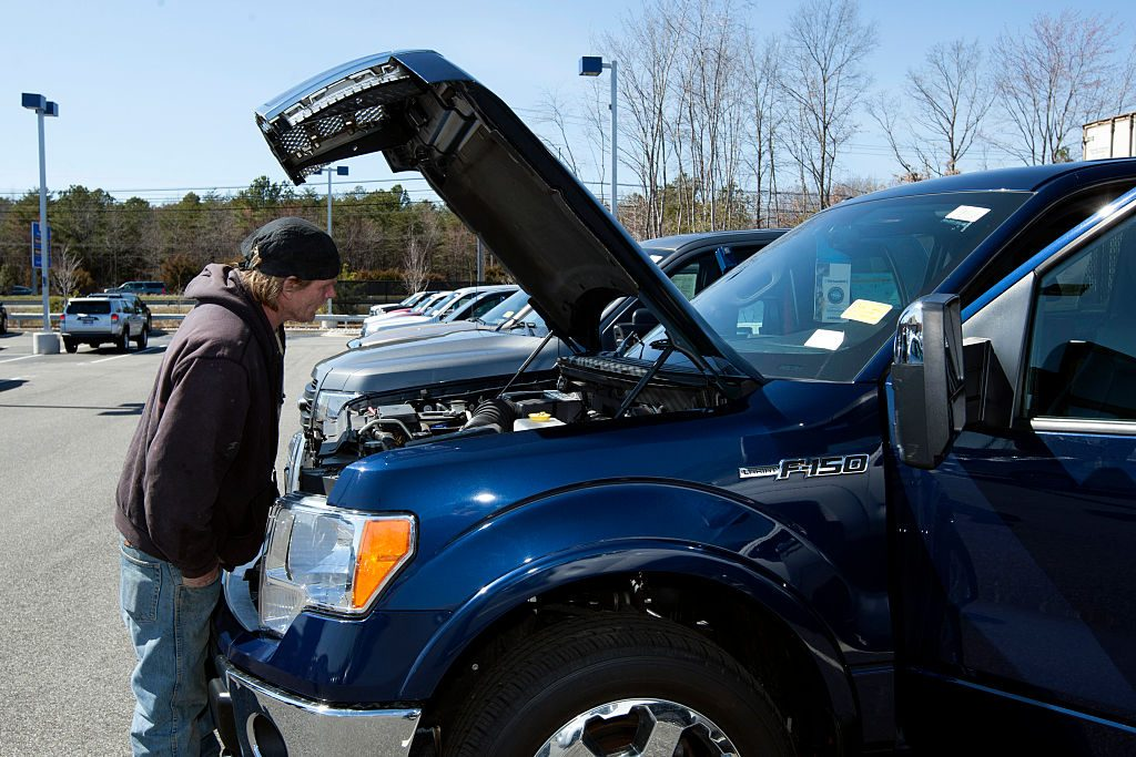 A customer looks at a Ford Motor Co. F-150 pickup truck at a CarMax Inc. dealership in Brandywine, Maryland, U.S., on Sunday, March. 29, 2015. Photographer: Hasan Sarbakhshian/Bloomberg via Getty Images