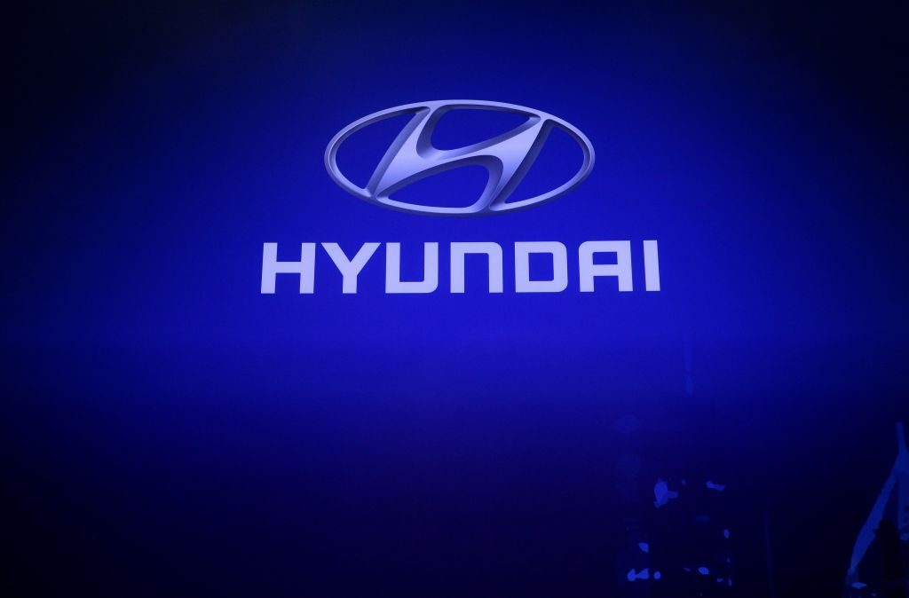Hyundai logo on a blue screen.