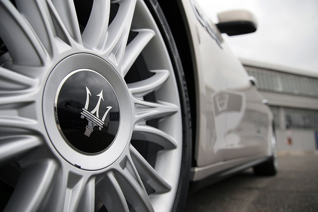 Maserati logo on the wheel of a car.