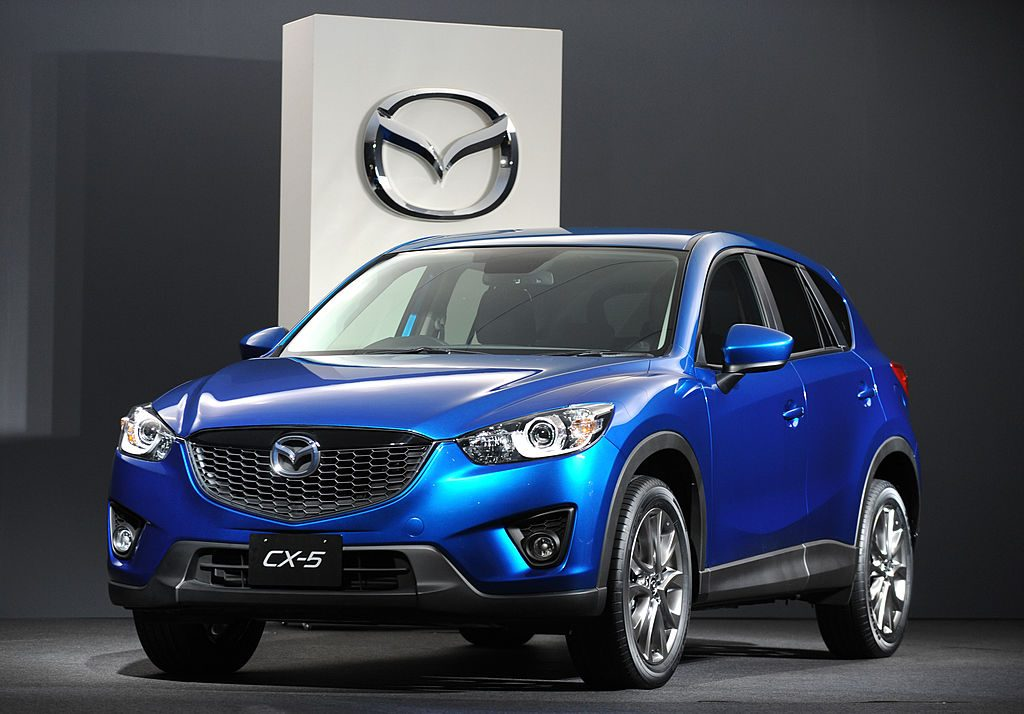 A blue Mazda CX-5 on display at a car show
