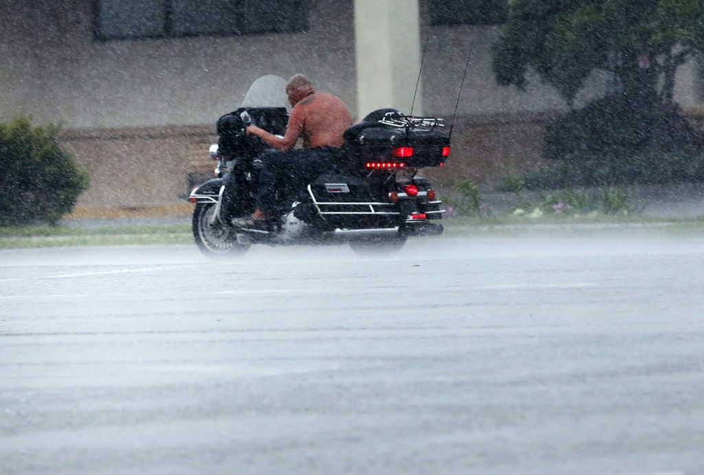 A motorcycle driver in the rain