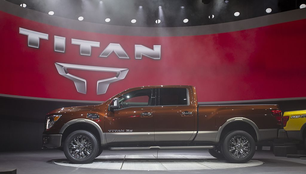A Nissan Titan truck on display at an auto show.
