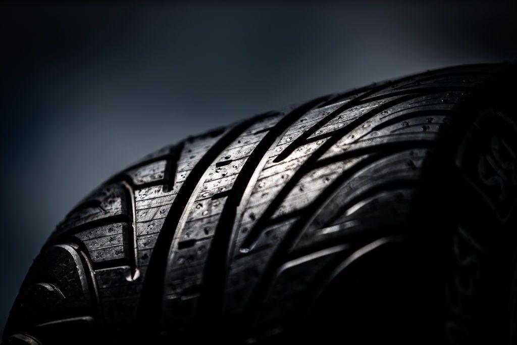 A wet car tire closeup