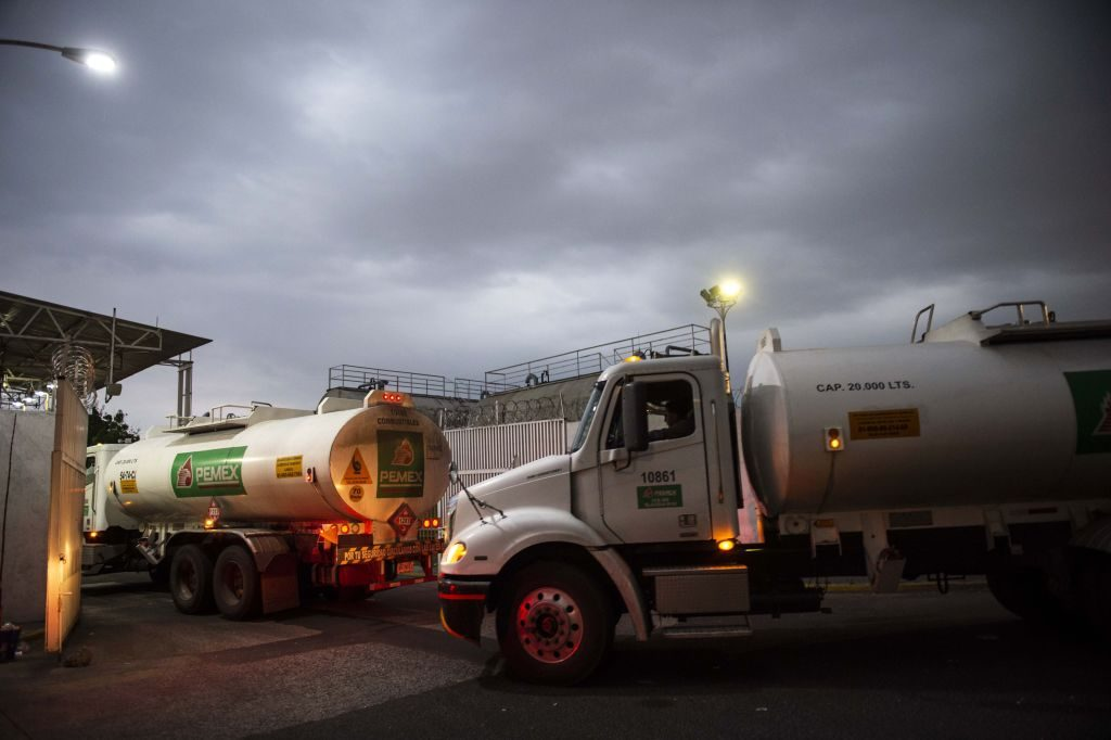 Semi-trucks fill up with fuel