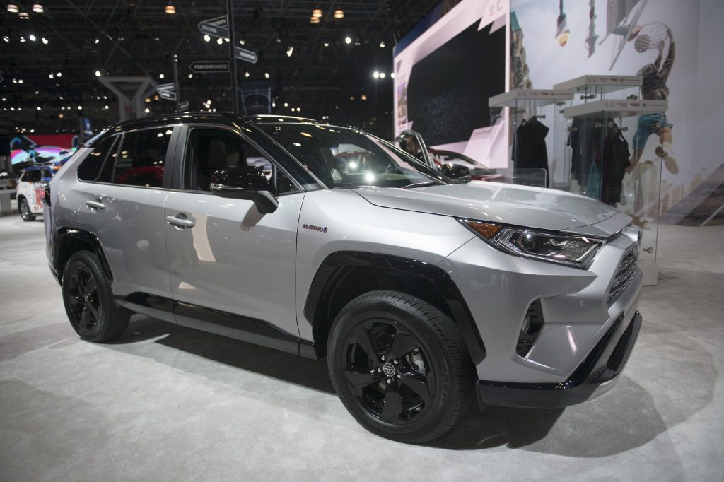 A silver Toyota RAV4 on display at an auto show.
