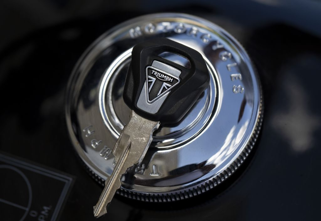 The logo of Triumph on a motorcycle key