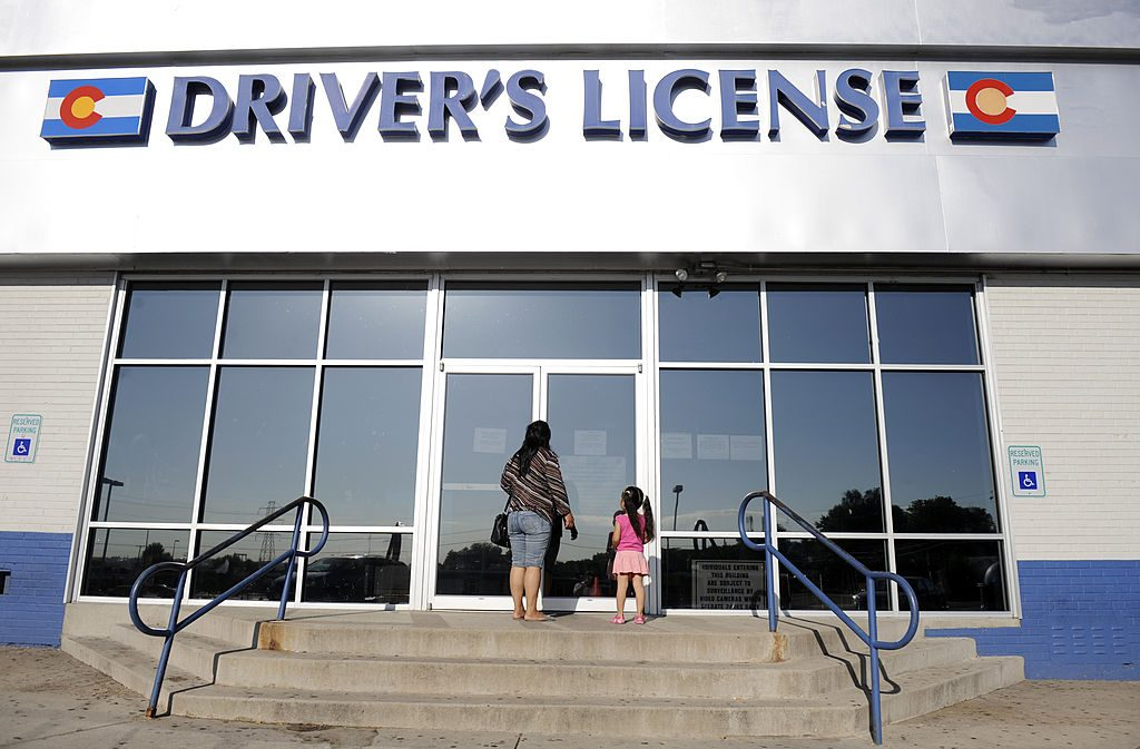 Woman and daughter enter the Denver DMV to get a driver's license
