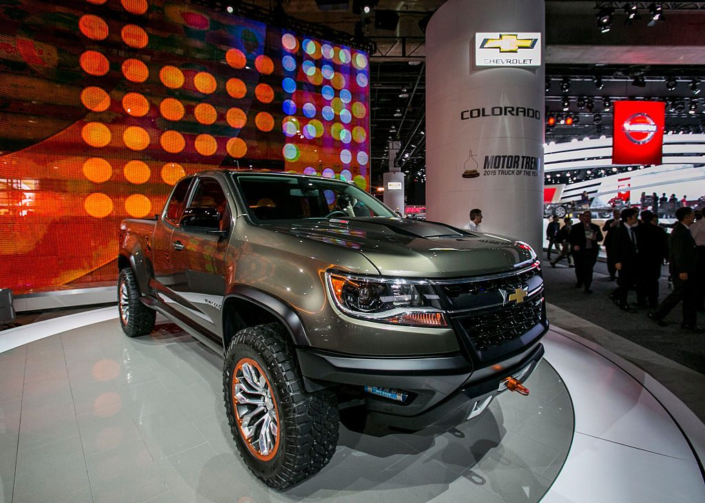 A 2015 Chevy Colorado on display at an auto show