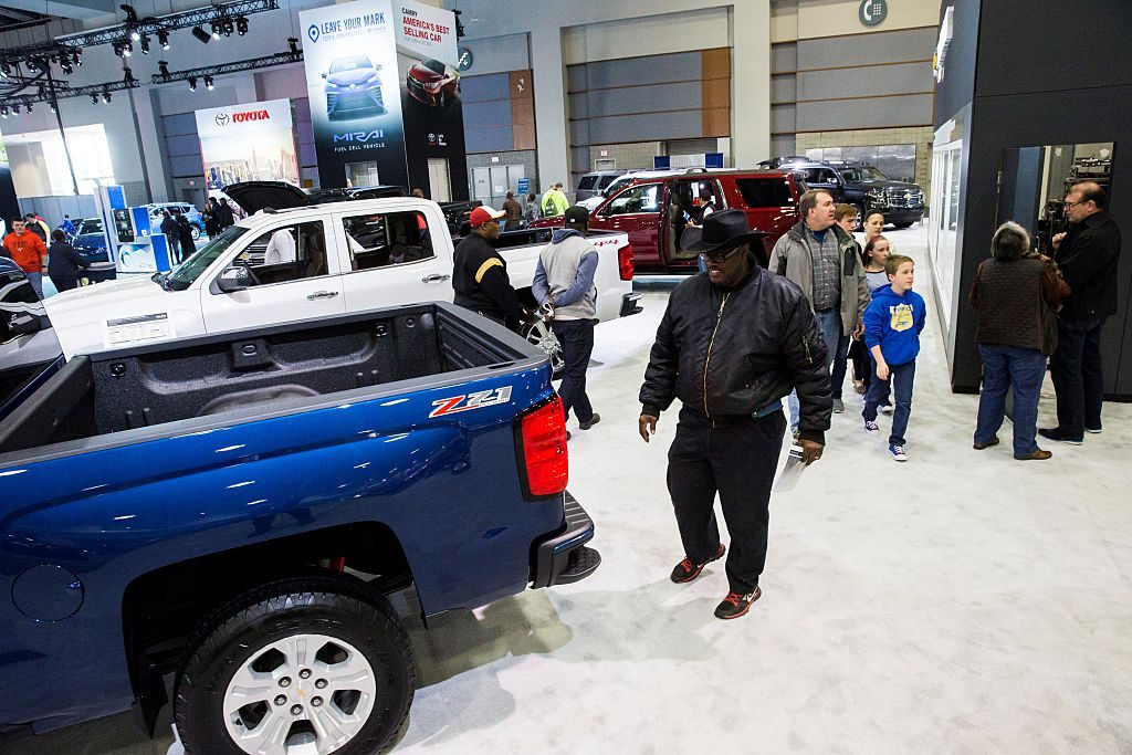 A man looks at the 2016 Chevrolet Silverado 1500 truck