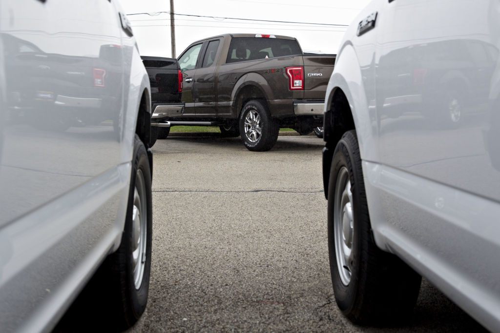2017 Ford F-150 pickup trucks sit on display