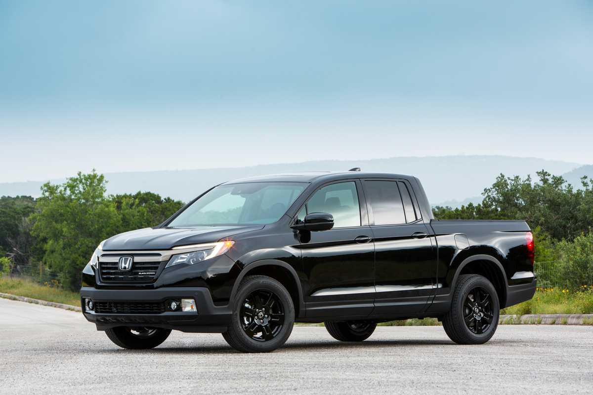 A blacked out Honda Ridgeline shows of as one of the best small pickup trucks in 2018