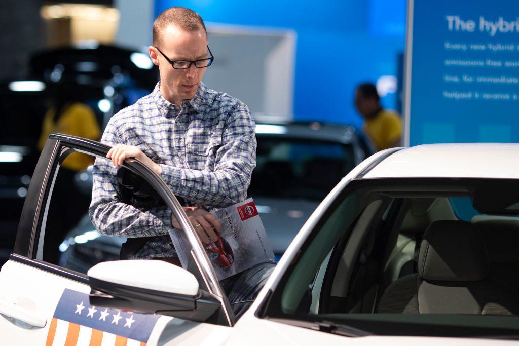 A show guest steps inside a 2019 Honda Civic
