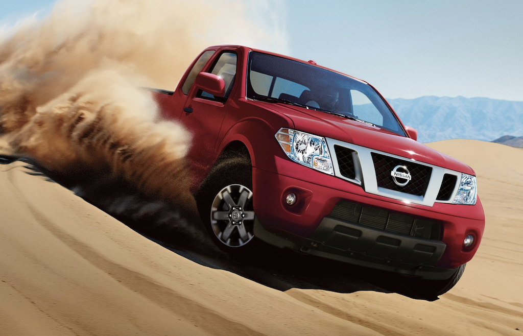 The 2019 Nissan Frontier drives down a sand dune