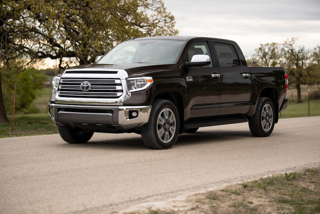 The 2019 Toyota Tundra drives on a country road