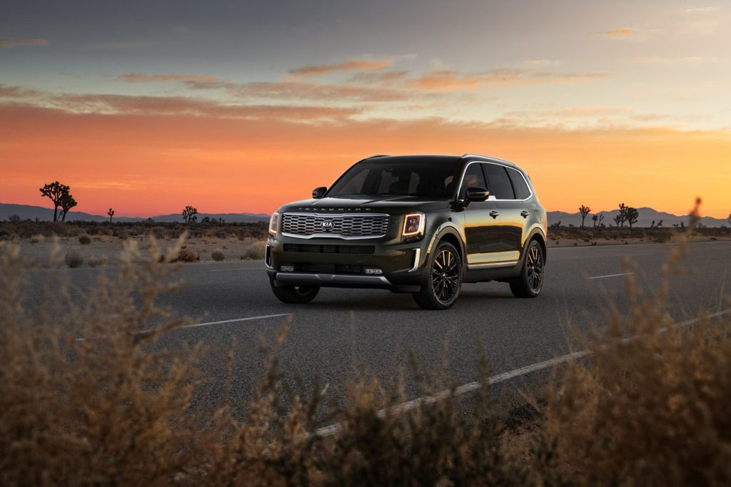 2020 Kia Telluride driving at dusk