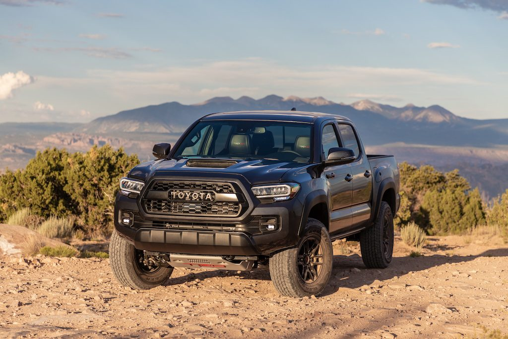 2020 Toyota Tacoma TRD parked in sand on a mountain top