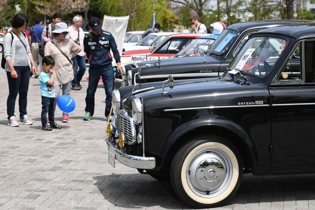 A 1959 Datsun 1000 sedan is displayed during the Motor Sport Japan 2017