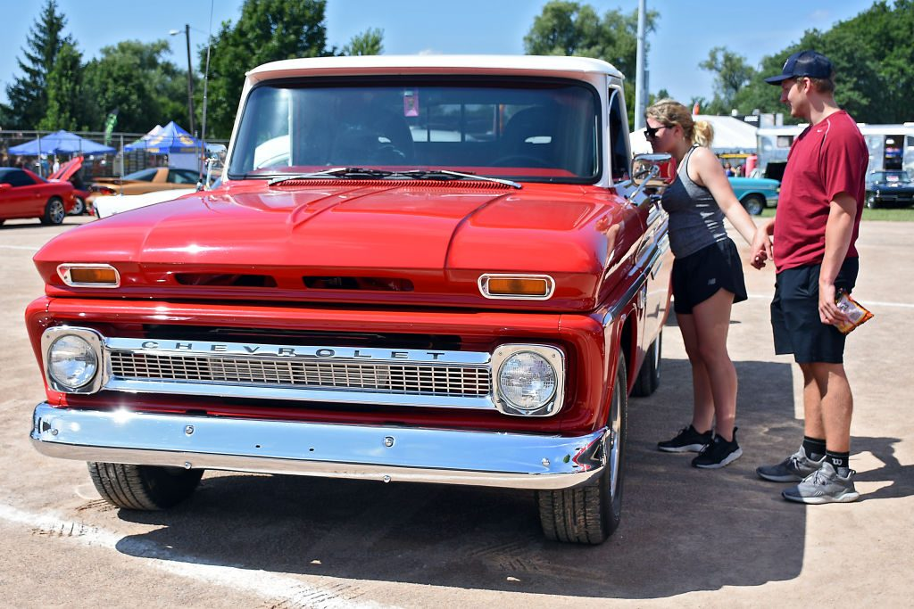 Event attendees check out a vintage Chevrolet pickup truck
