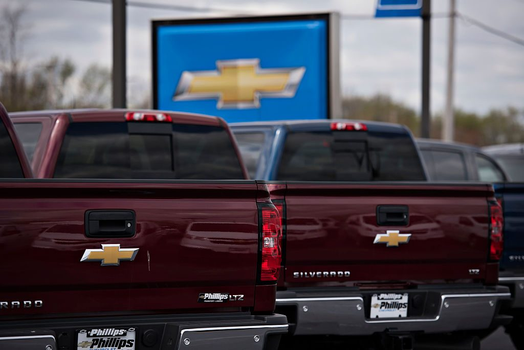 Chevy Silverado pickup trucks displayed for sale at a dealership.