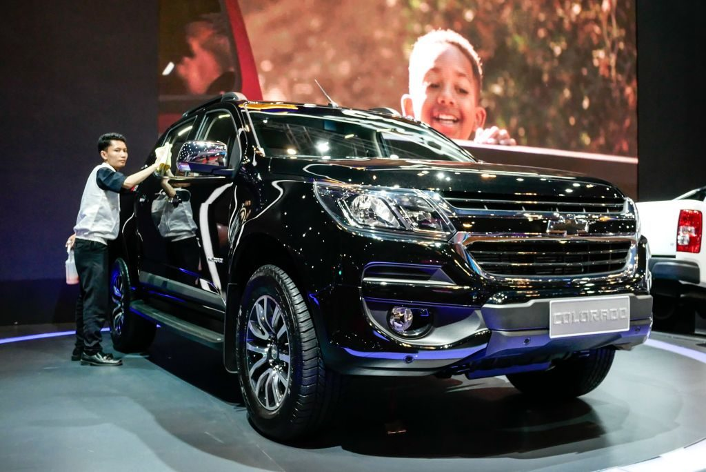 A worker cleans the Chevrolet Colorado at the 2019 Indonesia International Motor Show