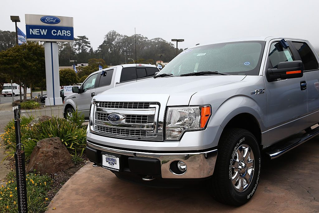 A new Ford F-150 for sale on a dealership lot.