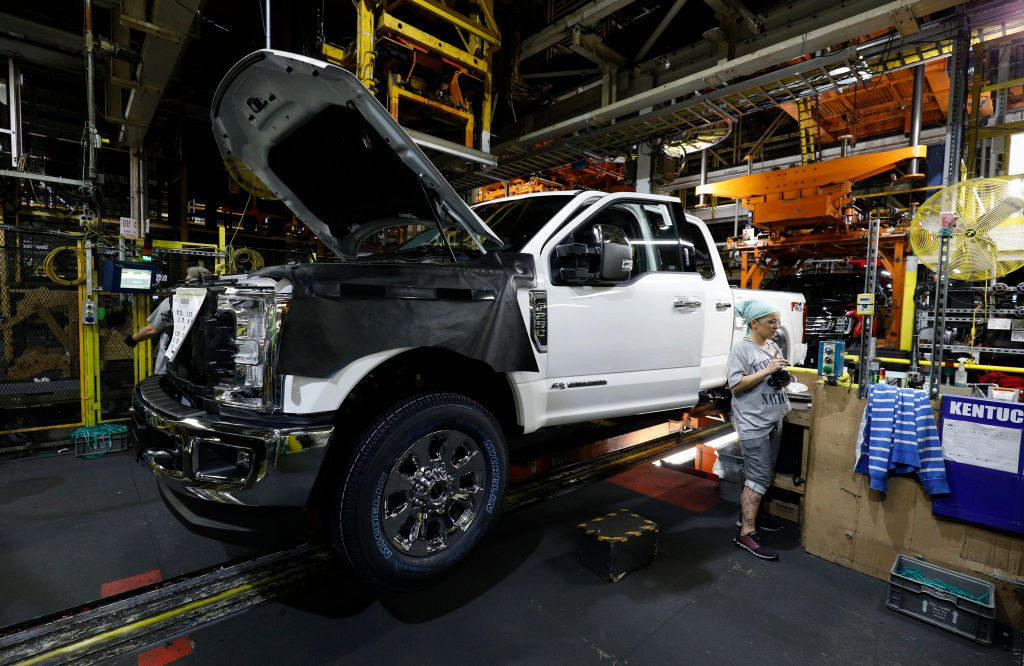 A worker builds a Ford F-250 as it goes through the assembly line at the Ford Kentucky Truck Plant