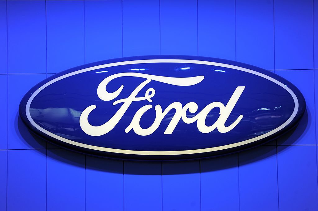 A Ford logo displayed at an auto show.