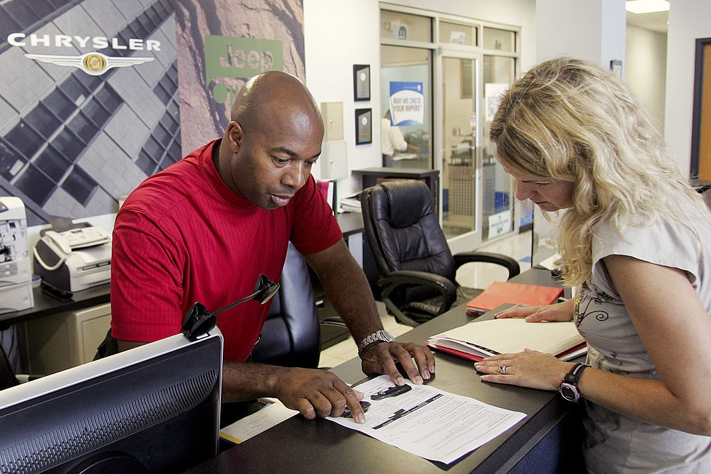 A customer works with a dealership salesperson.