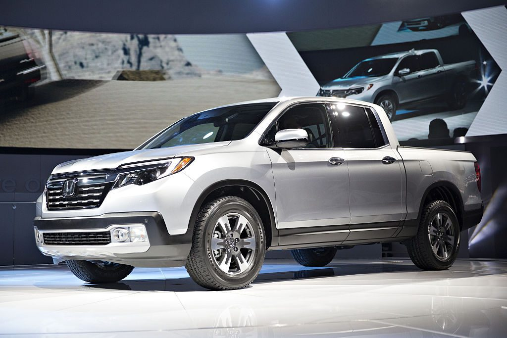A Honda Ridgeline on display at an auto show.